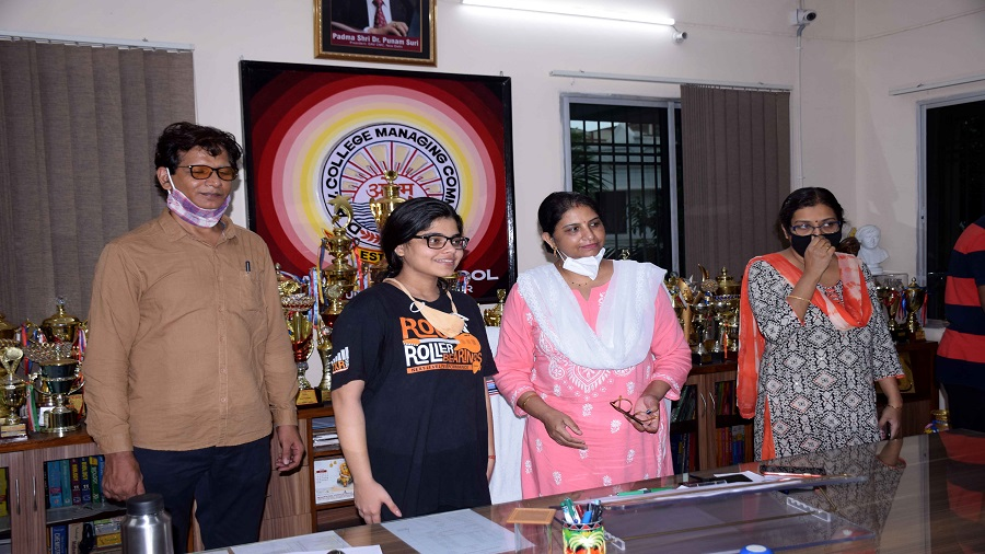 Principal of DAV Public School-Bistupur Pragya Singh (in pink) with one of the toppers in Jamshedpur on Monday