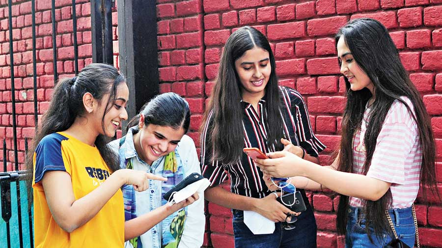 Girls in New Delhi celebrate their success after the announcement of  CBSE Class XII results on Monday.
