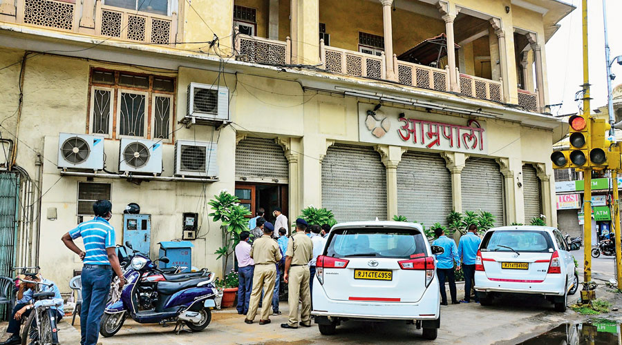 Income tax officials conduct a raid at the office and jewellery showroom of Congress party member Rajiv Arora in Jaipur  on Monday.