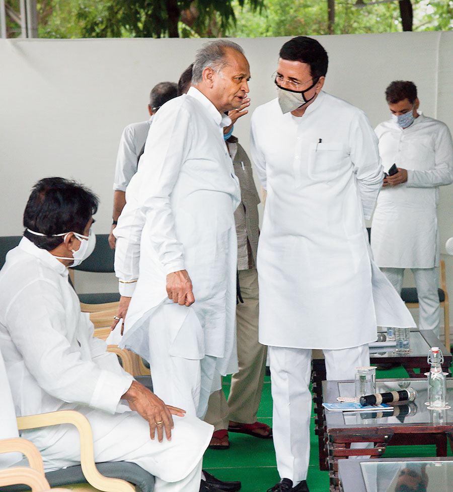 Ashok Gehlot (left) and Randeep Surjewala at a meeting with MLAs in Jaipur on Monday.