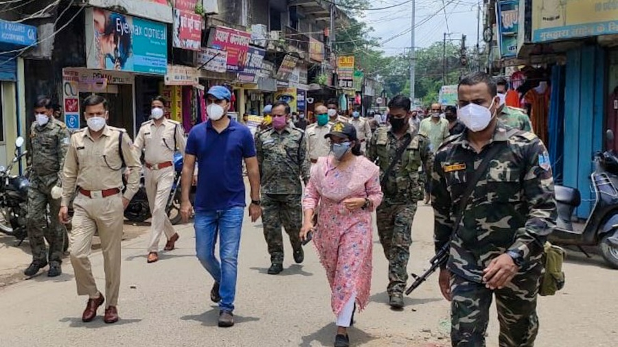 The Ramgarh deputy commissioner and superintendent of police along with other administrative officials and police officers walk as part of a flag march from Subhash Chowk to Chatti Bazar.  During the flag march, shopkeepers were instructed to follow Covid-19 guidelines