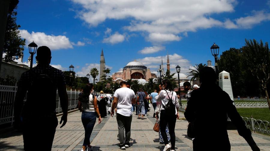 People walk towards the Hagia Sophia in Istanbul on July 11
