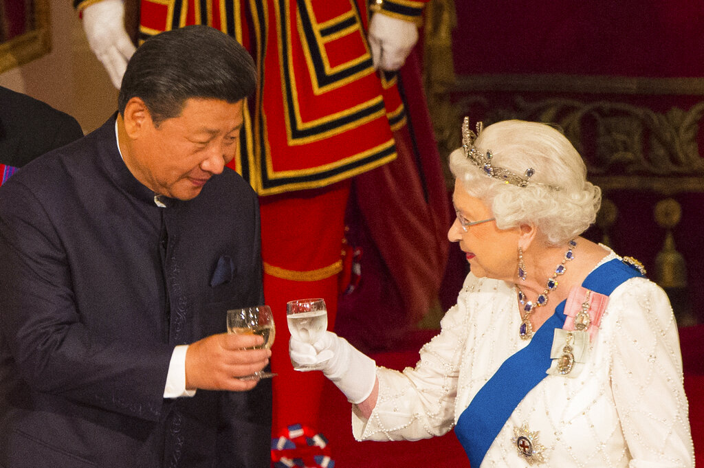 Queen Elizabeth II shares a light moment with Chinese President Xi Jinping at Buckingham Palace