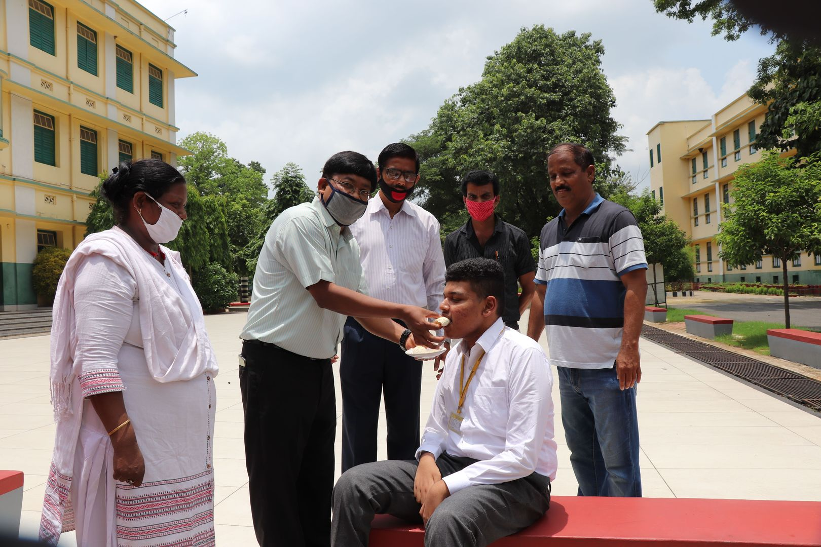 Principal of St.Xavier's school Father Roshner Xalxo offers sweet to Kunal Raj in Hazaribagh on Tuesday