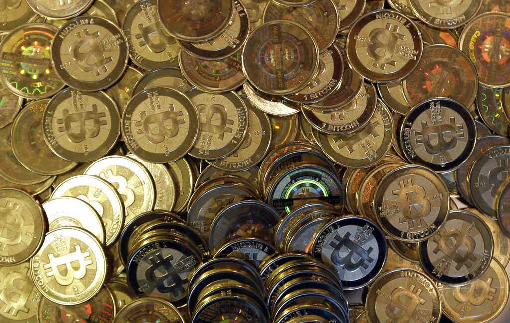 This April 3, 2013, file photo shows bitcoin tokens in Sandy, Utah.