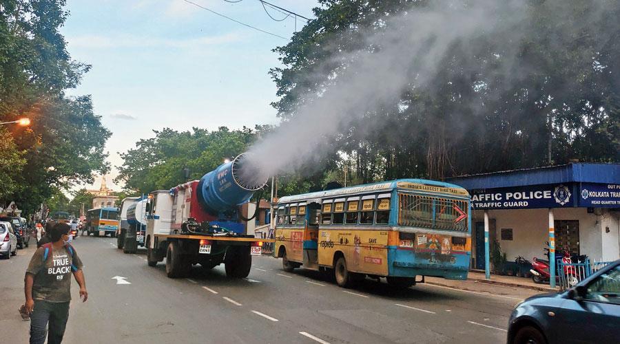 Virus vigil: A Calcutta Municipal Corporation mist cannon sprays sanitiser in Esplanade on Thursday.