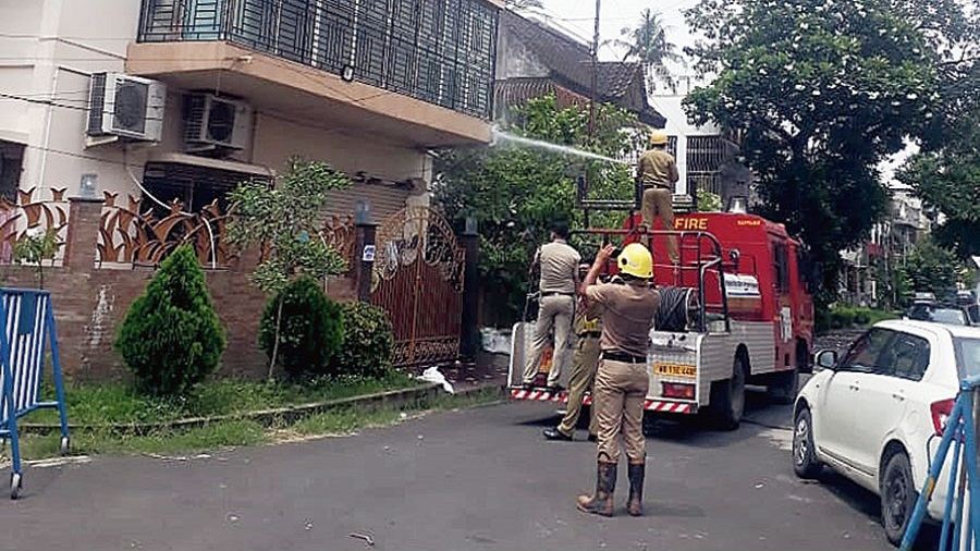 Firemen sanitise the contained stretch of BE block