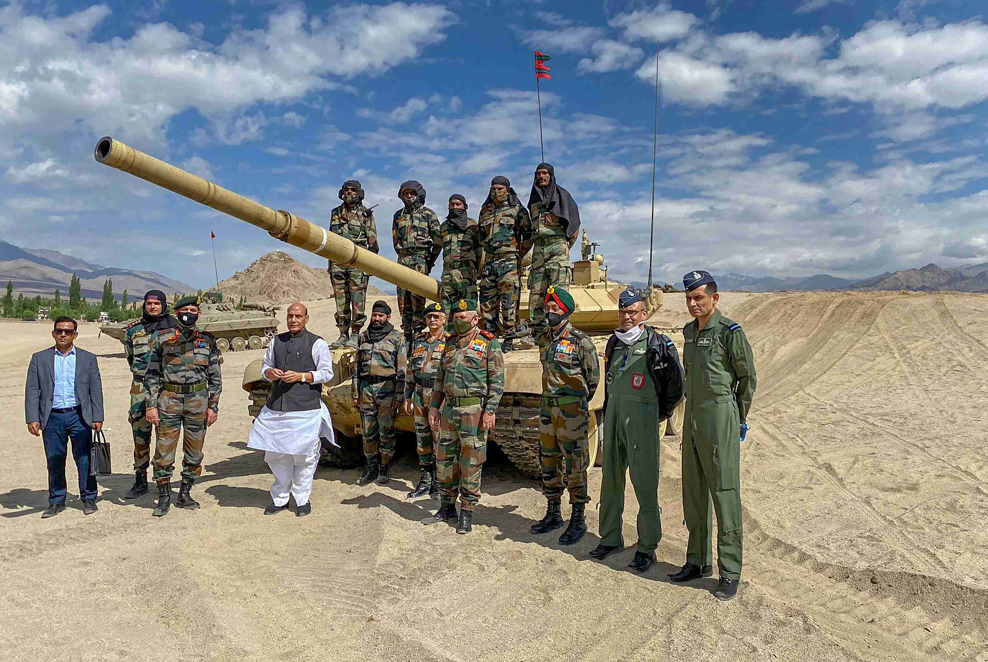 Rajnath Singh poses with troops who took part in para dropping and other military exercises in Leh, Ladakh, Friday, July 17, 2020.