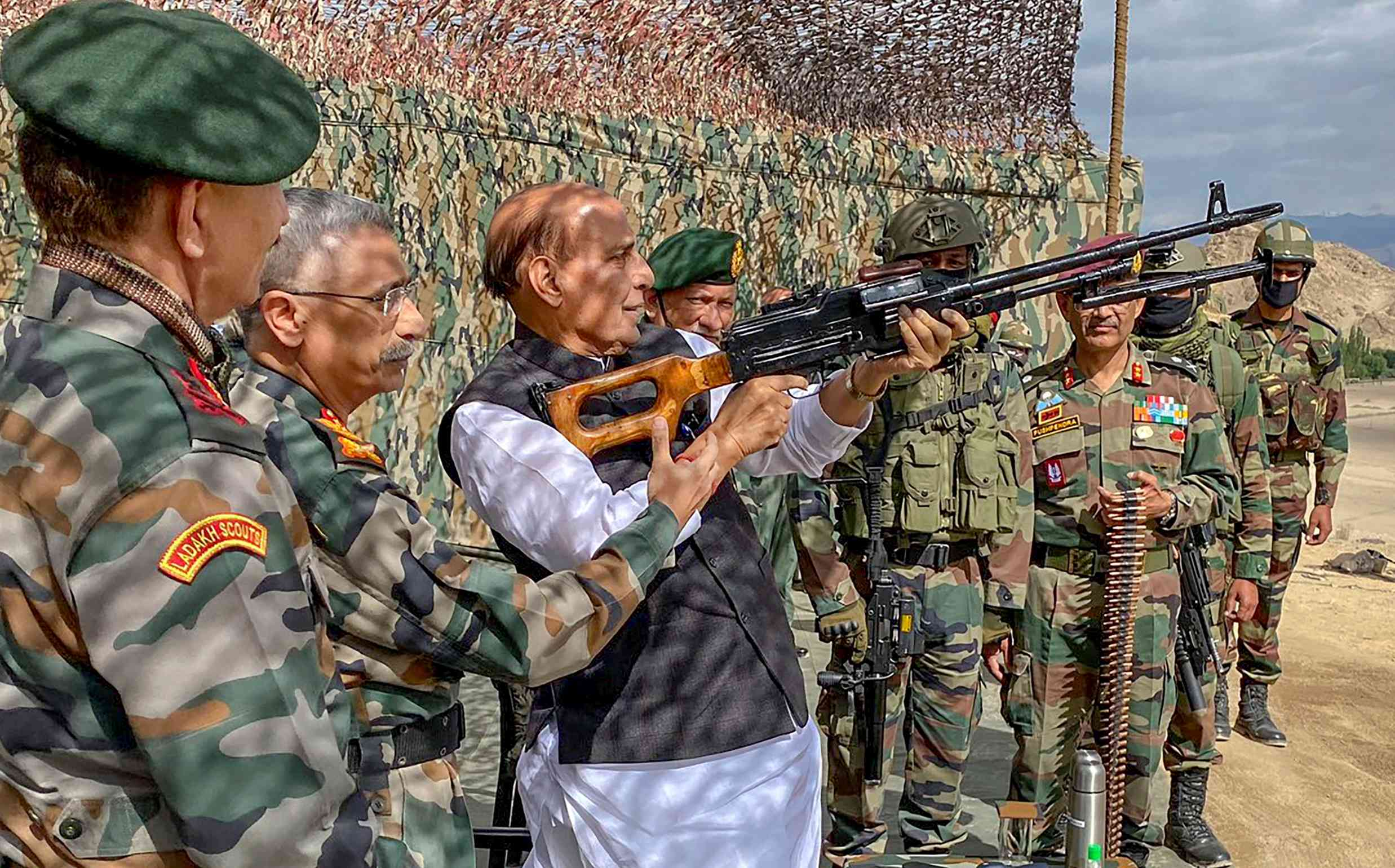 Defence minister Rajnath Singh check scoping rifles during a para dropping exercise in Skatna, Leh, Friday, July 17, 2020.
