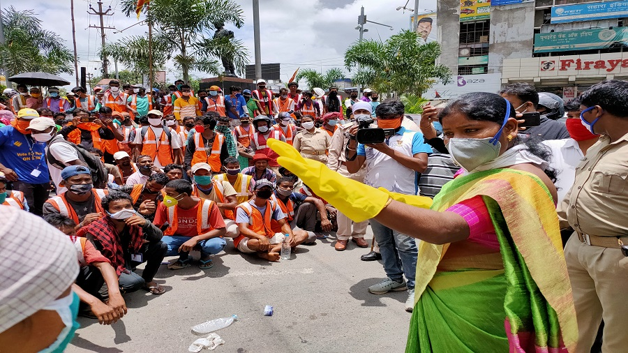 Ranchi mayor Asha Lakra (right, in green saree) addressing sanitation workers of Ranchi Municipal Corporation (RMC), who assembled at Albert Ekka Chowk on Friday demanding a continuance of their monthly incentive of Rs 2000. RMC had promised to pay the workers when they agreed to work during the lockdown, but stopped the payment in June on grounds of being cash-starved, and awaiting government funds.