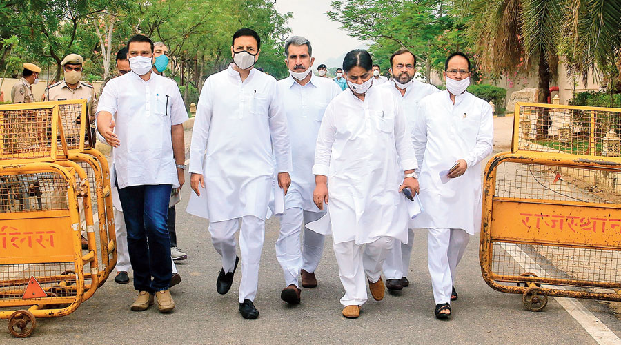 Congress communications chief Randeep Surjewala (second from left) and other party leaders arrive  to address the media in Jaipur on Friday.