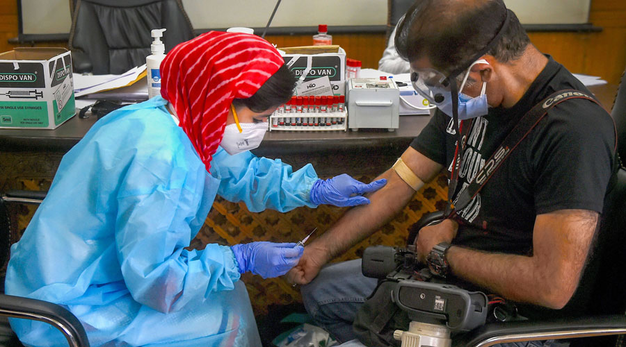 A doctor takes samples for Covid-19 immunoglobulin (Ig) Blood test at Government Medical College in Srinagar on Wednesday, July 15, 2020.