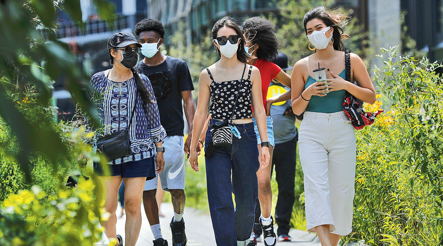 People wearing masks at the High Line Park in New York on Thursday