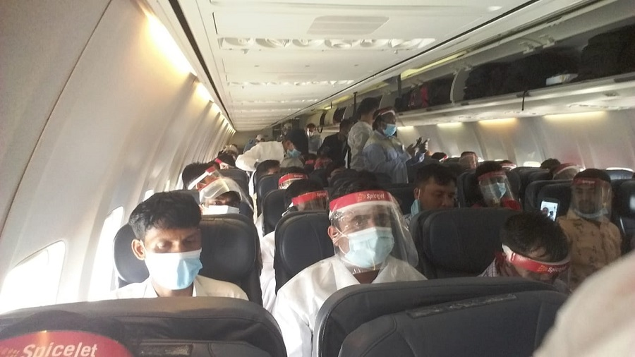 Workers from Abu Dhabi on their flight to Hazaribagh on Sunday