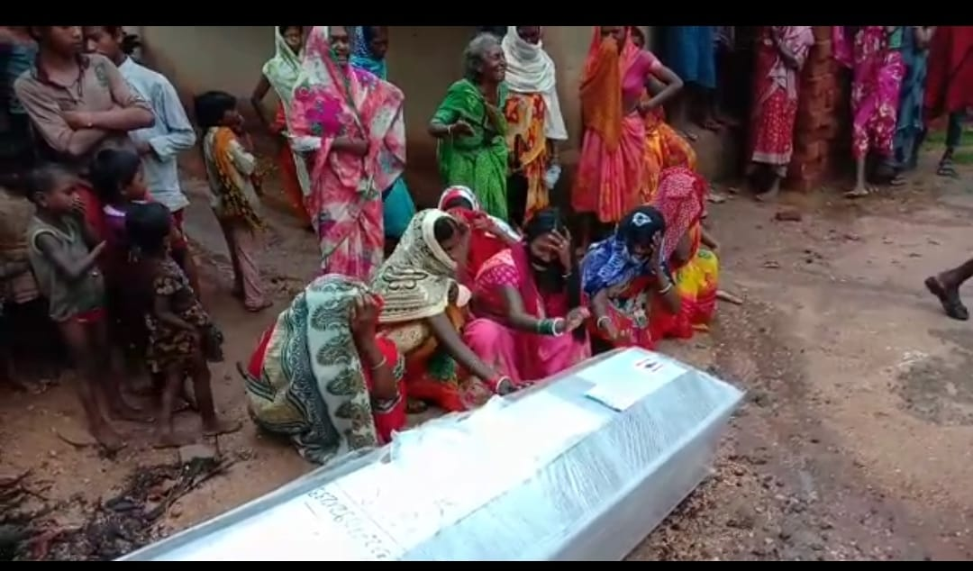 Relatives cry after the arrival of a dead body in Vishnugarh village on Sunday