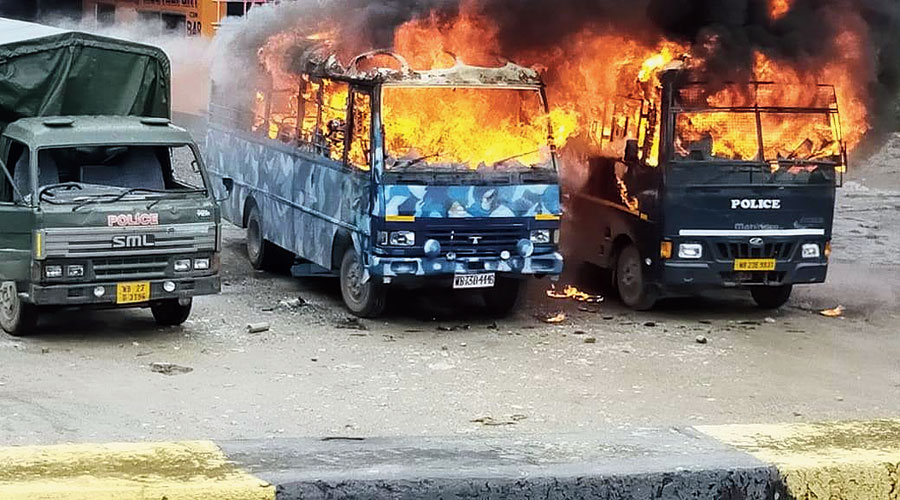 Police vehicles torched by the mob at Chopra in North Dinajpur on Sunday.