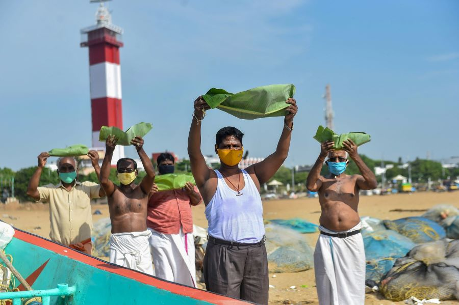 People perform rituals for salvation of their ancestors on the occasion of Aadi Amavasya at Marina Beach, in Chennai, Monday, July 20, 2020.