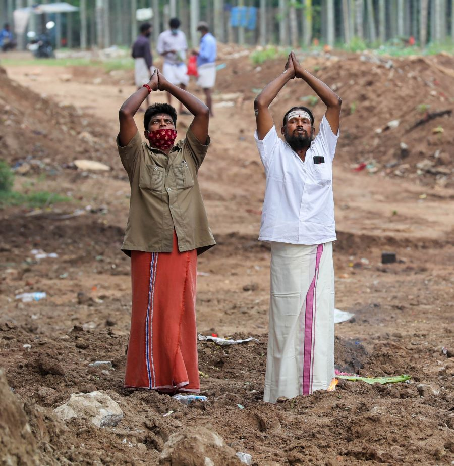 Priests offer prayers for salvation of their ancestors on the occasion of 'Aadi Amavasya in Coimbatore, Monday