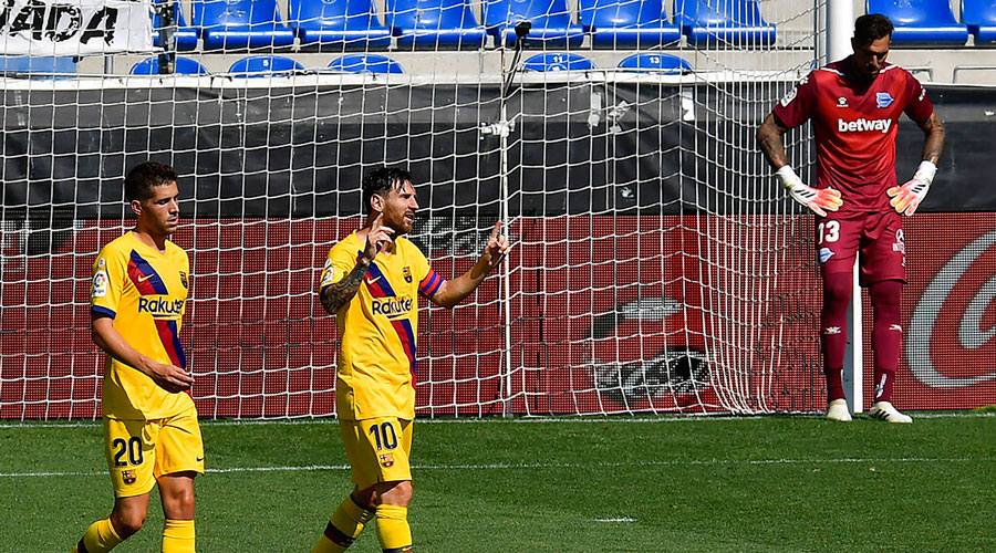 Lionel Messi celebrates one of his goals against  Deportivo Alaves on Sunday.