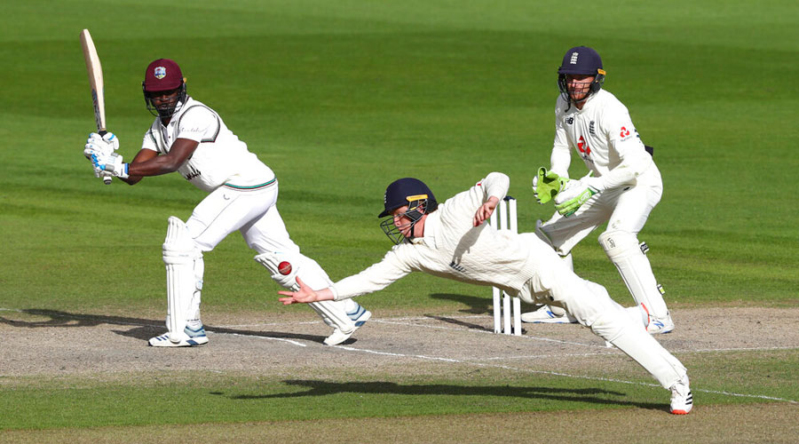 Ollie Pope takes a catch to dismiss Kemar Roach of the West Indies as England  win the second Test at Old Trafford on Monday.