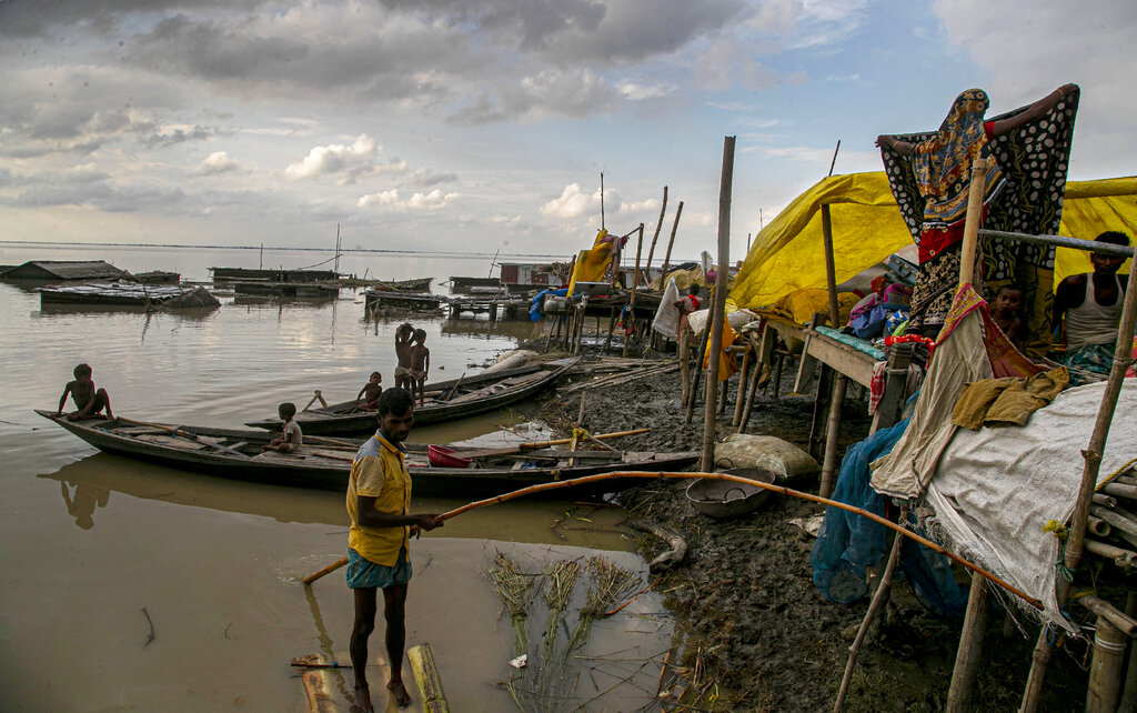 Flood affected people take shelter at temporary structures along the Brahmaputra River in Morigaon district, Assam, Thursday, July 16, 2020