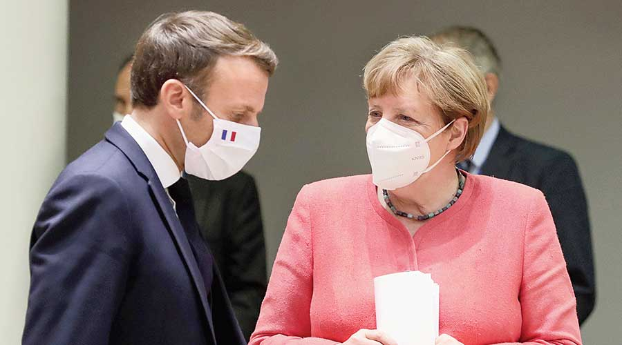 French President Emmanuel Macron and German Chancellor Angela Merkel in Brussels on Tuesday