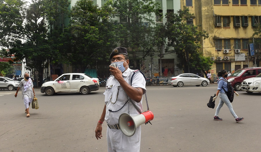 A policeman announces for the 2-day lockdown every week amid COVID-19 pandemic, in Calcutta, Wednesday, July 22, 2020.