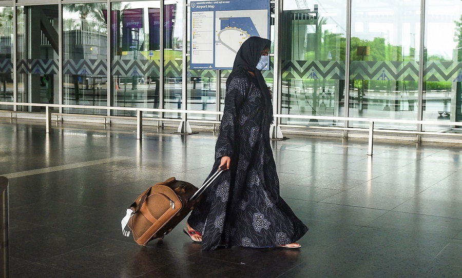A passenger walks outside NSCBI Airport, during weekly two-day complete lockdown to curb the spread of coronavirus disease, in Calcutta, Thursday, July 23, 2020.