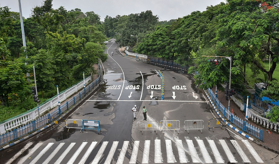A city road wears a deserted look during the weekly two-day complete lockdown to curb the spread of coronavirus disease, in Calcutta, Thursday, July 23, 2020