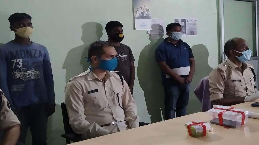 Senior SP M. Tamil Vanan (extreme right) with the three persons arrested for the murder of lawyer Prakash Yadav at Sakchi in Jamshedpur on Thursday