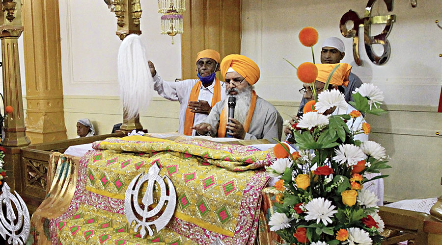 Sikhs worship at the Gurdwara Sri Guru Singh Sabha in Quetta on Thursday.