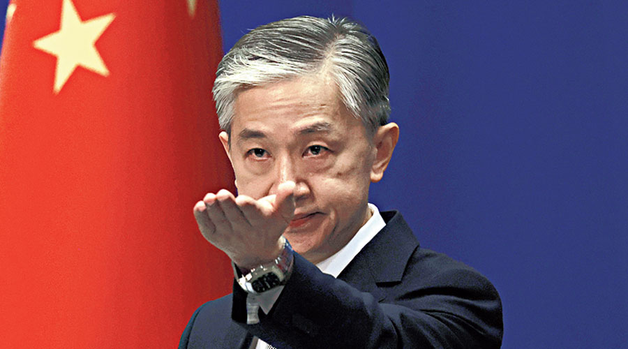 Chinese foreign ministry spokesperson Wang Wenbin points to a reporter at the briefing in Beijing on Thursday.