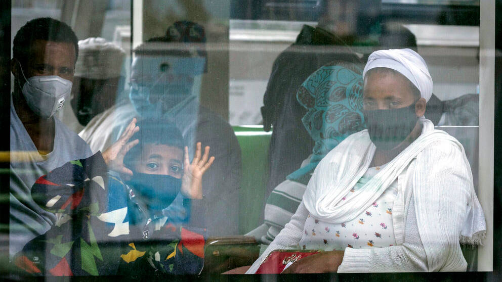 Ethiopians wear masks to curb Covid spread as they ride on the Addis Ababa Light Rail transport system, Ethiopia, Thursday, July 23, 2020.