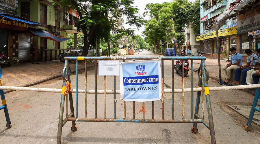 Barricades set up outside a locality, identified as a COVID-19 containment zone, during Unlock 2.0, in Kolkata, Monday, July 20, 2020.