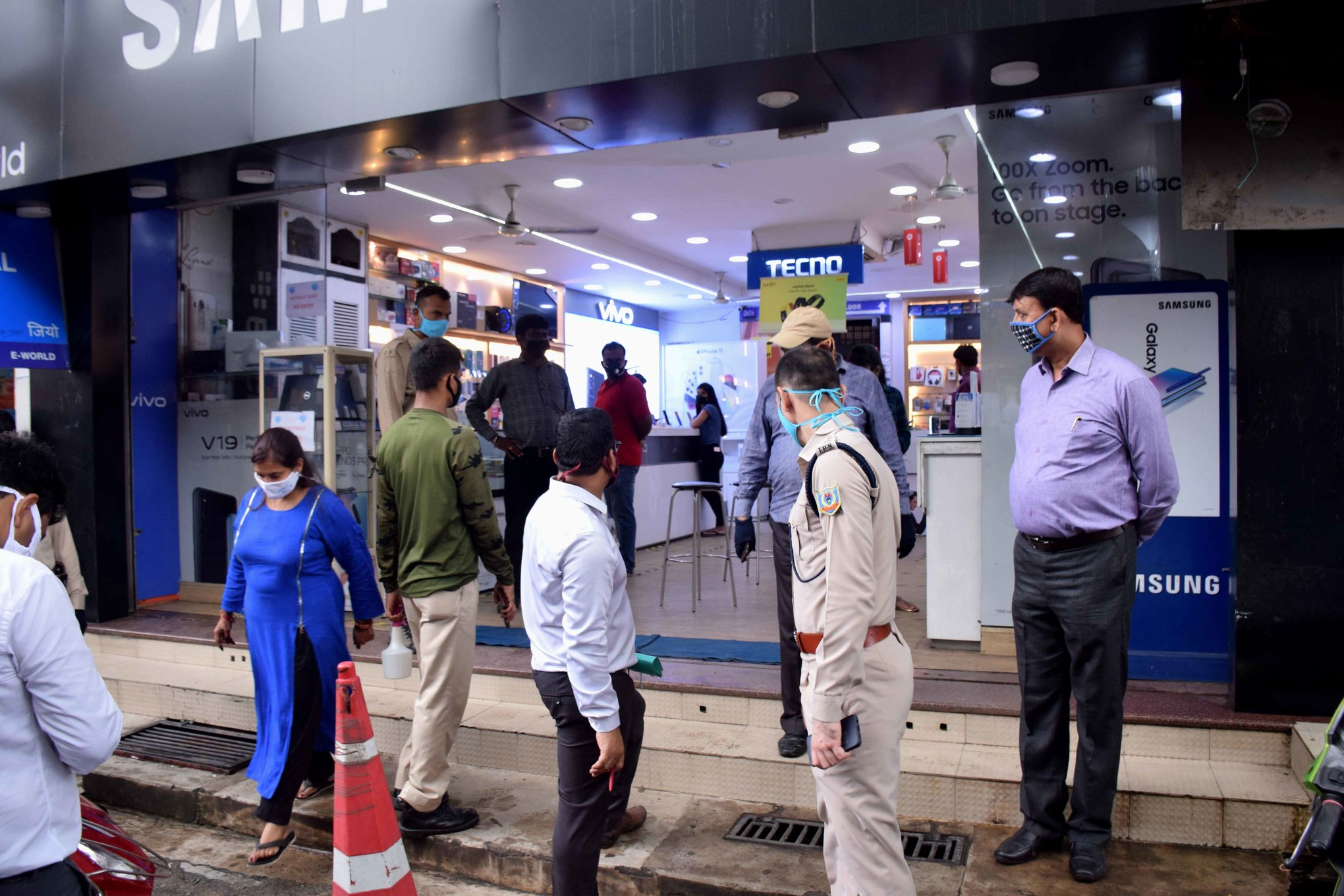City SP Subhash Chandra Jat (in uniform) and his team conduct a surprise check at a shop at Sakchi in Jamshedpur on Friday
