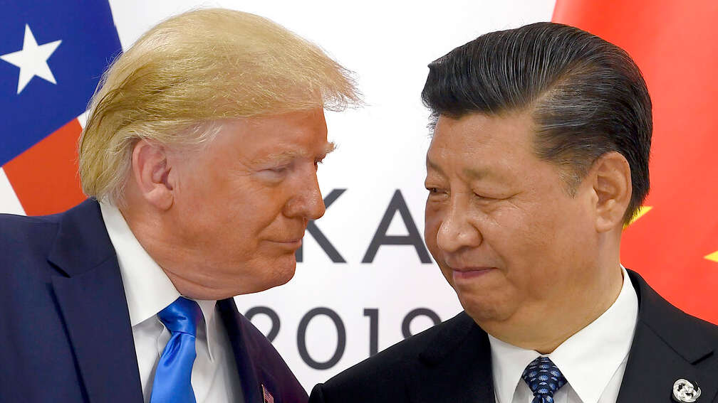In this Saturday, June 29, 2019 photo, Donald Trump, left, meets with Xi Jinping on the sidelines of the G-20 summit in Osaka, Japan.