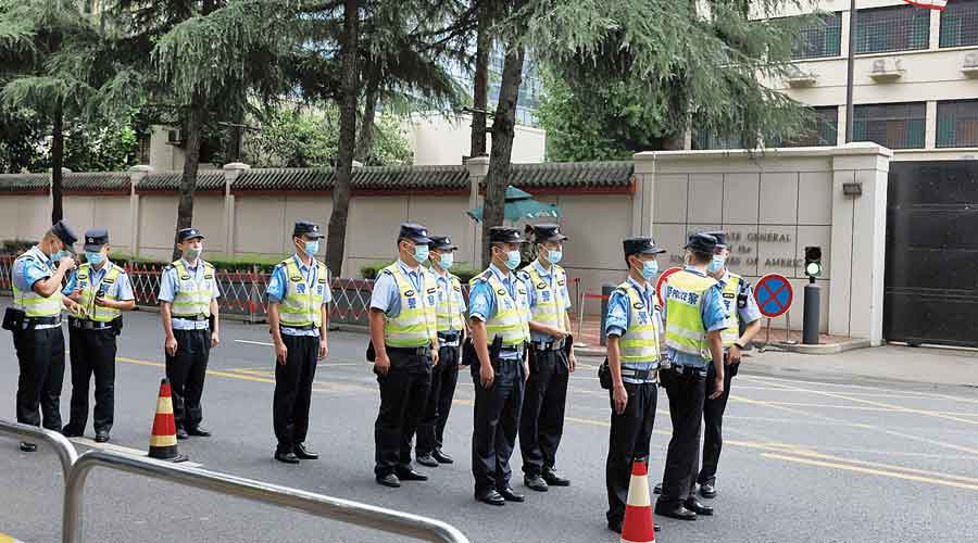 Chinese police officers outside the US consulate in Chengdu, China, on Saturday