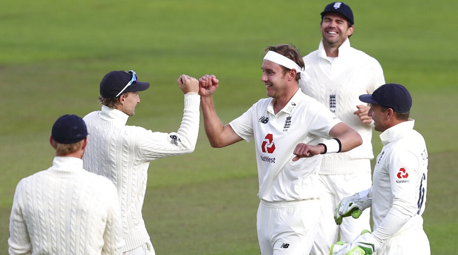 Stuart Broad celebrates the dismissal of John Campbell with teammates on Sunday