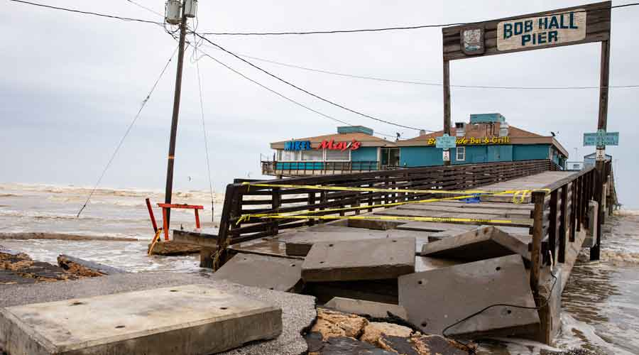 Bob Hall Pier is taped off the morning after Hurricane Hanna on Sunday
