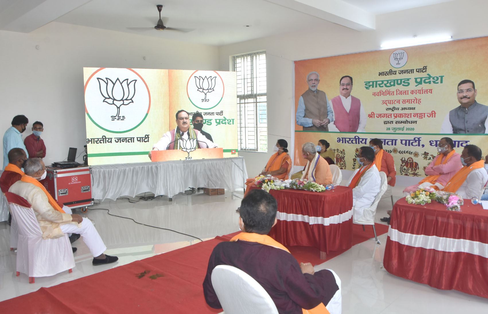 BJP leaders listen to the address of party chief J.P. Nadda during the online inauguration of a new party office at Baliapur Road in Dhanbad on Tuesday