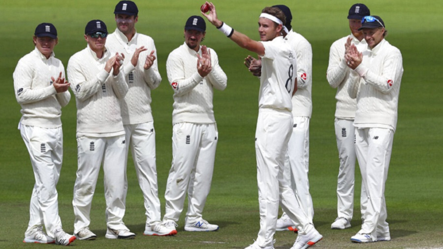Teammates applaud Stuart Broad after he dismissed Kraigg Brathwaite for his 500th Test wicket  at Old Trafford on Tuesday.