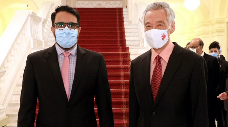 Indian-origin politician Pritam Singh (left) with Singapore's Prime Minister Lee Hsien Loong