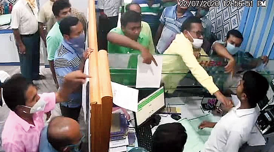 A grab from the CCTV footage of the row inside the cooperative bank in Nadia on July 22