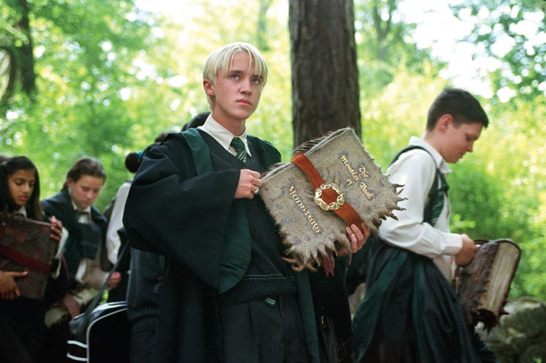 Draco Malfoy with the Monster Book of Monsters
