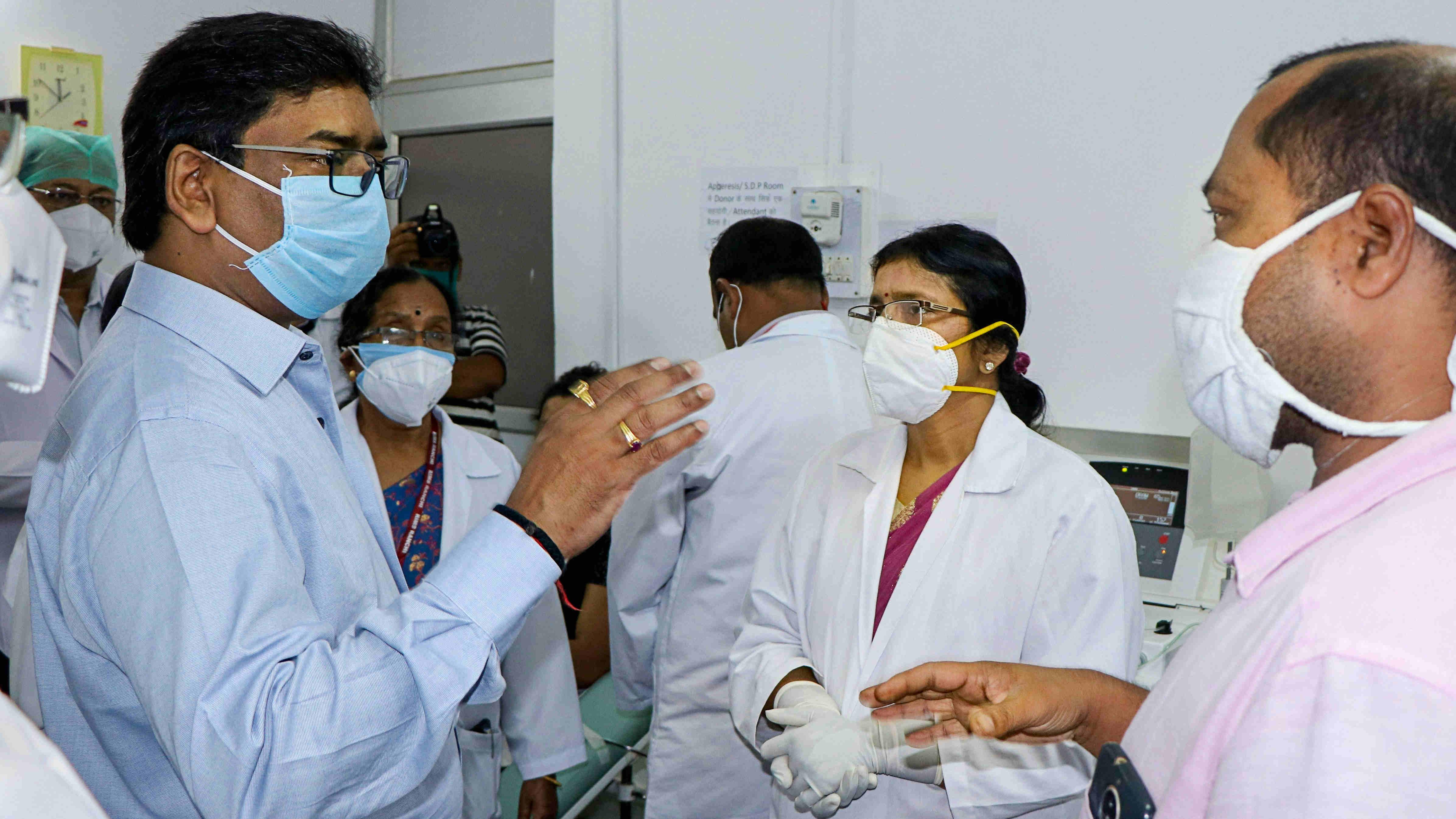 Hemant Soren interacts with medics during inauguration of Plasma Bank at RIMS, Ranchi, Tuesday, July 28, 2020.