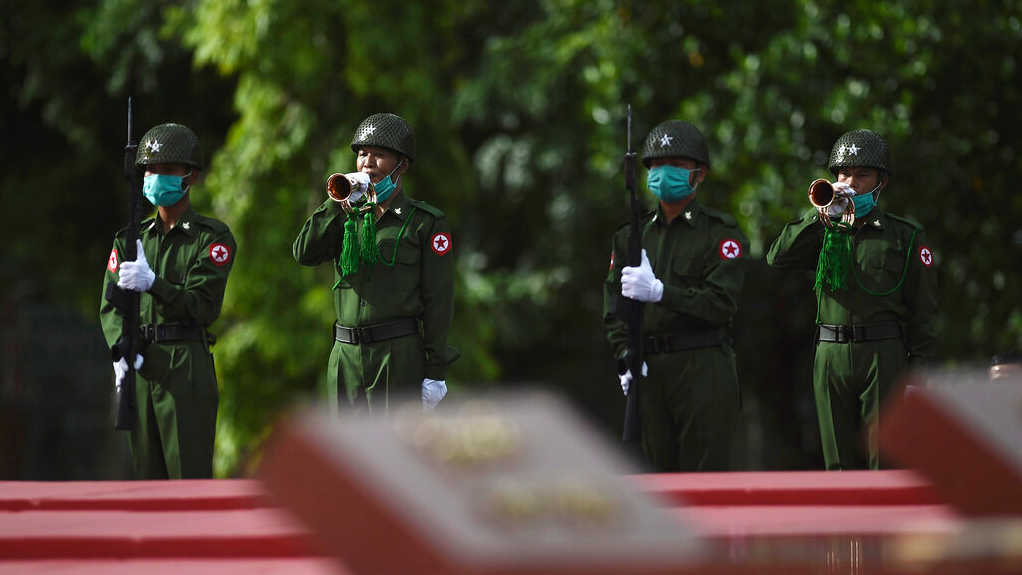 Soldiers during a ceremony to mark the 73rd anniversary of the 1947 assassination of independence heroes, Sunday, July 19, 2020, in Yangon.