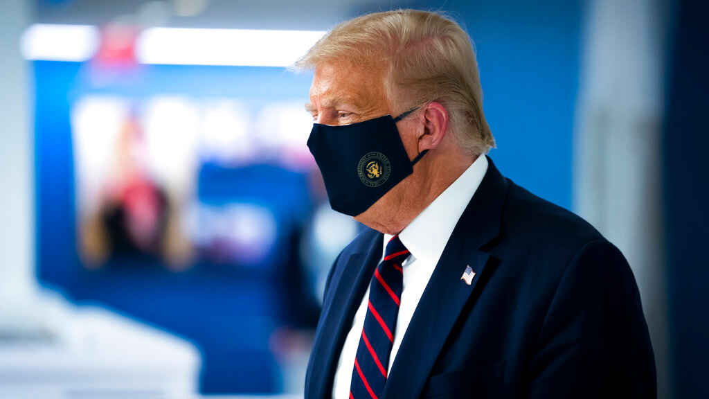 Donald Trump wears a face mask as he tours the American Red Cross national headquarters in Washington, Thursday, July 30, 2020.