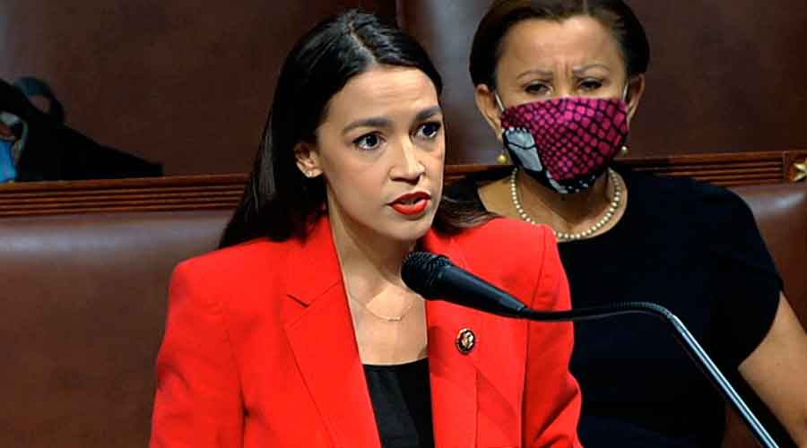 Rep. Alexandria Ocasio-Cortez, D-N.Y., speaks on the House floor on Thursday, 23 July, on Capitol Hill in Washington.