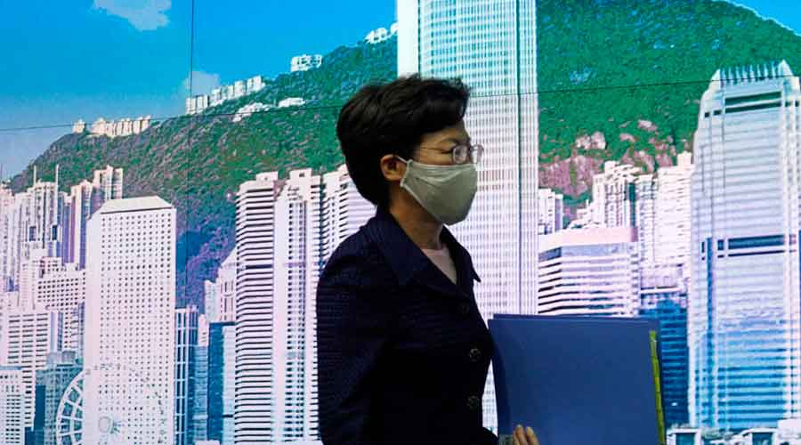 Hong Kong chief executive Carrie Lam arrives to attend a news conference in the city on Friday