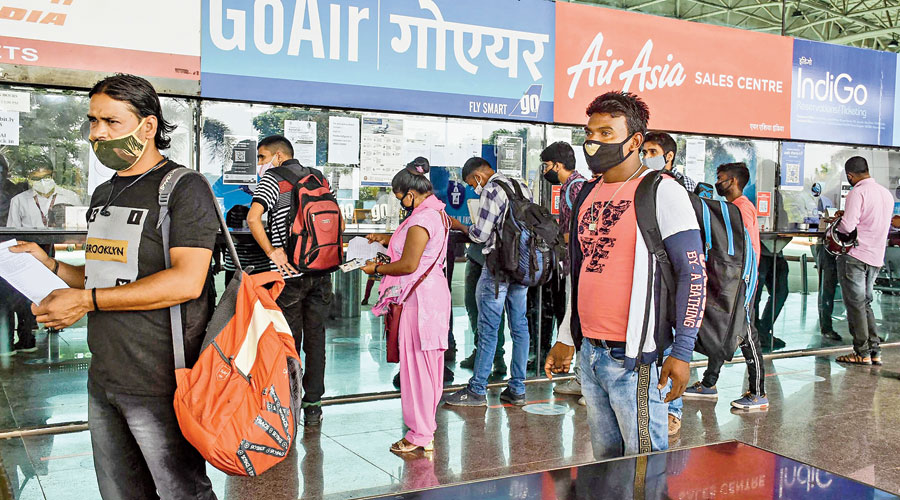 Migrants who came back from Bangalore in June because of the Covid-19 lockdown queue up at Birsa Munda International Airport in Ranchi on Friday to return to their places of work.